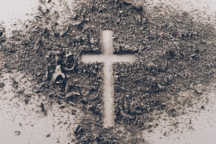 Bed of ashes with cross