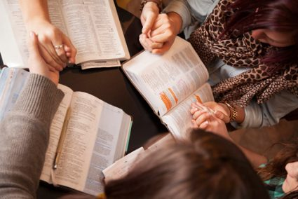 Small group studying Bible